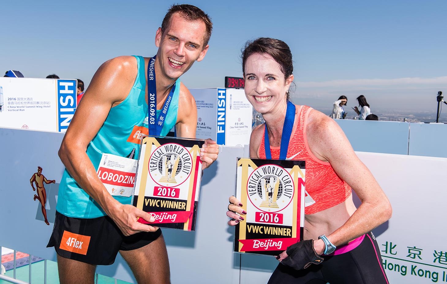 Winners Piotr Lobodzinski and Suzy Walsham. China World Summit Wing Hotel Vertical Run. ©Sporting Republic