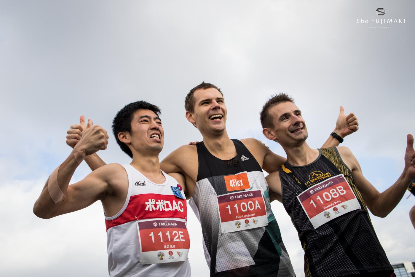 Men's podium, Ryoji Watanabe 3rd, Piotr Lobodzinski, winner, Emanuele Manzi, 3rd. © Sho Fujimaki