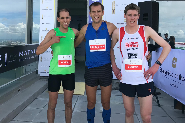Kerry Sports Manila Vertical Run podium. Bekkali, 3rd, Lobodzinski 1st, Bourne 2nd. ©Sporting Republic