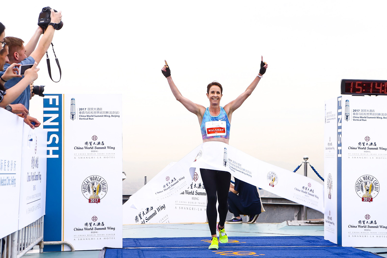 Race winner and VWC ranking leader Suzy Walsham summits China World Summit Wing Beijing Vertical Run. ©Sporting Republic
